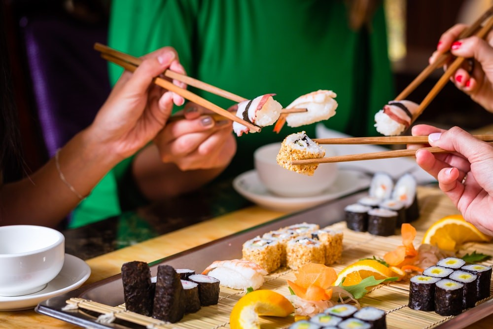 Group of people eating sushi