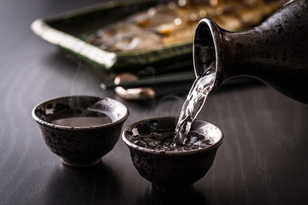 Sake being poured into cups